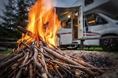 Rv Park Campfire In Front Of Motorhome Pitch. Summer Camping With Motorhome. poster