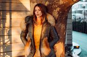 Gorgeous Pretty Woman In Furry Coat Jacket Stand Urban Background. Trendy Outfit. Her Confidence Is  poster