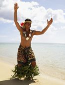 pic of pacific islander ethnicity  - Pacific Islander man in traditional dress on beach - JPG