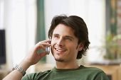 stock photo of idealistic  - Man talking on cell phone - JPG