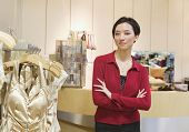image of flogging  - Mixed Race woman working in boutique - JPG