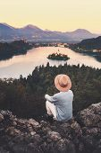 Traveling Young Woman Looking At Bled Lake, Slovenia, Europe poster