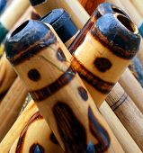 stock photo of didgeridoo  - A display of didgeridoos the world - JPG