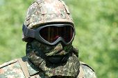 foto of hider  - The soldier in protective clothes with weapon - JPG