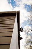 picture of downspouts  - Downspout on an urban house and sky - JPG