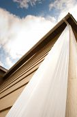 stock photo of downspouts  - Downspout on an urban house and sky - JPG