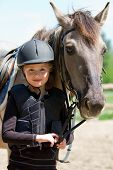 stock photo of feeding horse  - Horse and jockey  - JPG