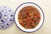 picture of tagine  - A moroccan beef tagine served in the traditional tagine dish - JPG