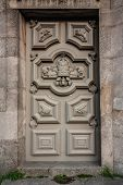 Gray Wooden Enterance Door. Old Fashioned Front Doors, All In Gray Colors With Rivet Ornaments. Mass poster