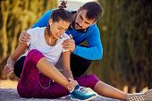 Girl injury at jogging.Woman runner. jogging outdoors. poster