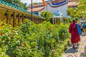 George Town Malaysia. March 8 2019. A Monk At Kek Lok Si Temple In George Town Malaysia poster