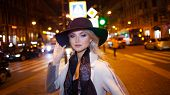 Stylish And Elegant Young Woman In A Beige Coat And Black Hat On The City . Night City In Autumn. Po poster
