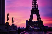 Scenic View Of The Eiffel Tower With Dramatic Pink And Purple Sky During Sunrise. Photo Taken From T poster