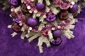 Purple Christmas Ornaments And Violet Tinsel Garlands On Artificial Christmas Tree With Purple Fur B poster