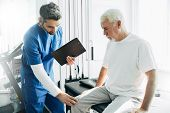 Physiotherapist Exam Patients Knee. Senior Patient With Knee Injury Visit His Physiotherapist poster