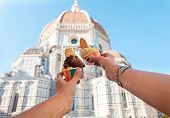 Womens Hands With Ice Cream Gelato On The Background Of The City Sight Cathedral Of Santa Maria Del poster