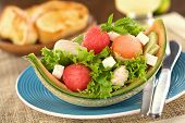 foto of muskmelon  - Fresh salad made of watermelon cantaloupe melon chicken cucumber cheese and lettuce  - JPG