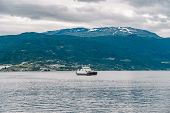 Ferry Boat Transportation Norway. White Passenger Ferry Goes On Fjord. In Norway. Ferry Crossing A F poster