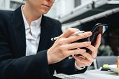 Close-up Of Businesswoman Using Smartphone For Conversation With Customers Digital Social Media Proj poster