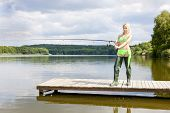picture of fisherwomen  - fishing woman standing on pier - JPG