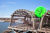 picture of lobster trap  - Lobster traps piled up on the wharf in rural Prince Edward Island - JPG