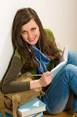pic of teenage girl  - Portrait of student teenager woman with piles of books - JPG