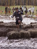 POCONO MANOR, PA - APR 28: A man runs through an obstacle with electrified wires at Tough Mudder on