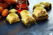 Baklava On Table. Middle Eastern Or Arabic Dishes. Turkish Dessert Baklava With Pistachio On Rustic poster