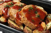 stock photo of meatloaf  - A deli container of sliced meatloaf and potatoes - JPG