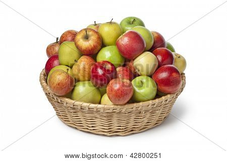 Basket full with different types of apples full frame