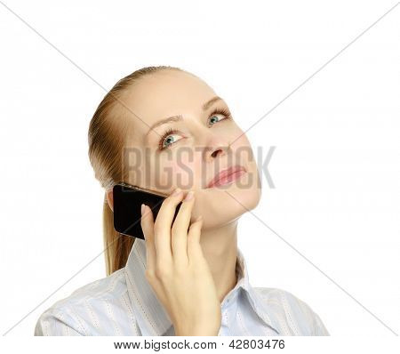 A young successful businesswoman talking on the phone, isolated on white background