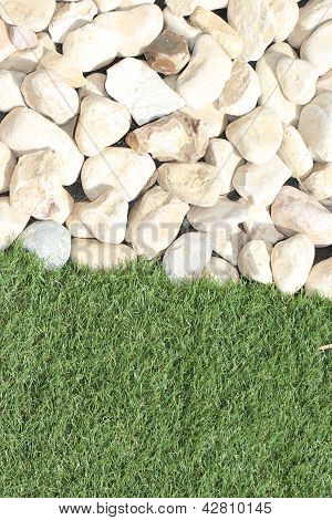 White Pebbles Against A Grassy Verge