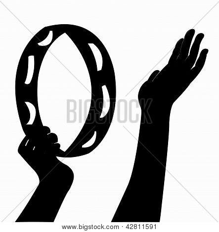 hand playing tambourine