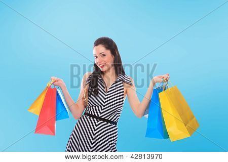 A shot of a woman with bags shopping outdoor