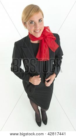 Smiling hostess with black uniform and red scarf