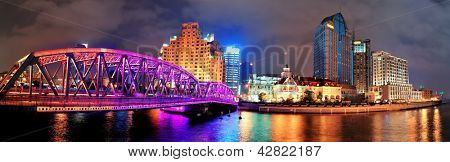 Shanghai Waibaidu bridge panorama at night with colorful light over river