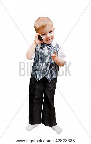 Beautiful little boy talking on a mobile phone pointing