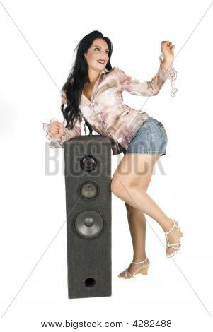 Woman Dancing Near Speaker