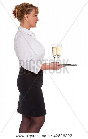 Profile of a waitress holding a silver tray with two glasses of Champagne, isolated on a white background.