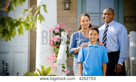 African American Family Stands On Porch
