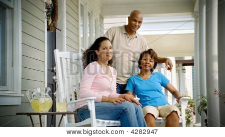 African American Family Relaxes On Porch 2