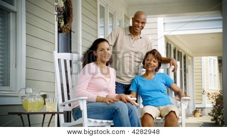 African American Family Relaxes On Porch