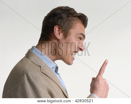 Anger businessman pointing finger.