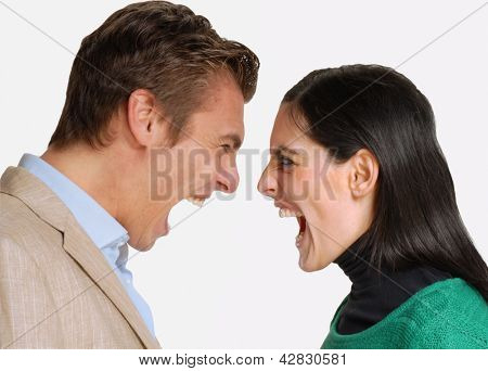 Anger young couple fighting and screaming.Shouting dispute
