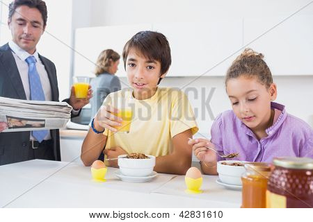 Family at breakfast time in the kitchen