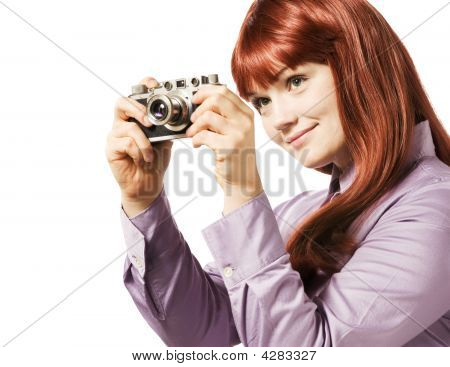 Young Woman Taking Picture With A Retro Camera