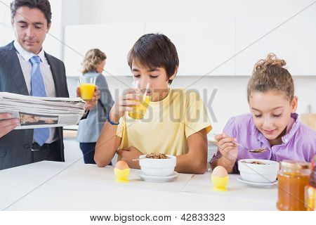 Cute family at breakfast time in kitchen