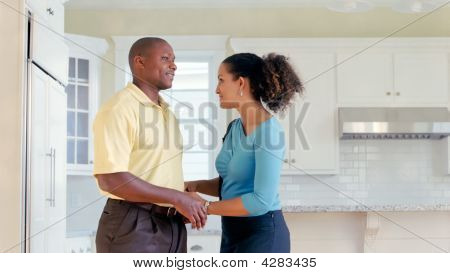 African American Couple Talk In Kitchen 2
