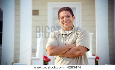 Hispanic Man Smiles At Camera With Arms Folded