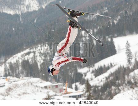 BBUKOVEL, UKRAINE - FEBRUARY 23: Travis Gerrits, Canada performs aerial skiing during Freestyle Ski World Cup in Bukovel, Ukraine on February 23, 2013.